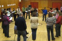 the workshop singers, learning 'hurrah for the orkneys'